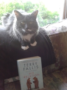 Smokey enjoying a nice summer read